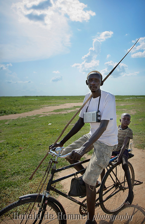 A Dinka fisherman in the South Sudanese town of Bor, the capital of Jonglei state is going to (spear) fish in the Sudd swamp on the shore of the Nile river.