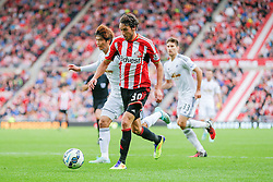 Will Buckley of Sunderland is challenged by Ki Sung-Yueng of Swansea City - Photo mandatory by-line: Rogan Thomson/JMP - 07966 386802 - 27/08/2014 - SPORT - FOOTBALL - Sunderland, England - Stadium of Light - Sunderland v Swansea City - Barclays Premier League.