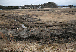 """Damaged fields and houses are seen in the Futaba District, located well within the 20-kilometer exclusion radius around the leaking facilities of Fukushima Daiichi nuclear power plant, in Fukushima Prefecture, Japan, March 7, 2015. The scenes from the towns and villages still abandoned four years after an earthquake triggered tsunami breached the defenses of the Fukushima Daiichi nuclear power plant, would make for the perfect backdrop for a post- apocalyptic Hollywood zombie movie, but the trouble would be that the levels of radiation in the area would be too dangerous for the cast and crew. The central government's maxim of """"Everything is under control"""" in and around the nuclear plant, has been a blatant lie since the disaster began to unfold on March 11, 2011, quickly escalating into the worst civilian nuclear crisis ever to happen, with twice the amount of radioactive materials being released into the environment than the Chernobyl disaster in 1986. EXPA Pictures © 2015, PhotoCredit: EXPA/ Photoshot/ Liu Tian<br /> <br /> *****ATTENTION - for AUT, SLO, CRO, SRB, BIH, MAZ only*****"""
