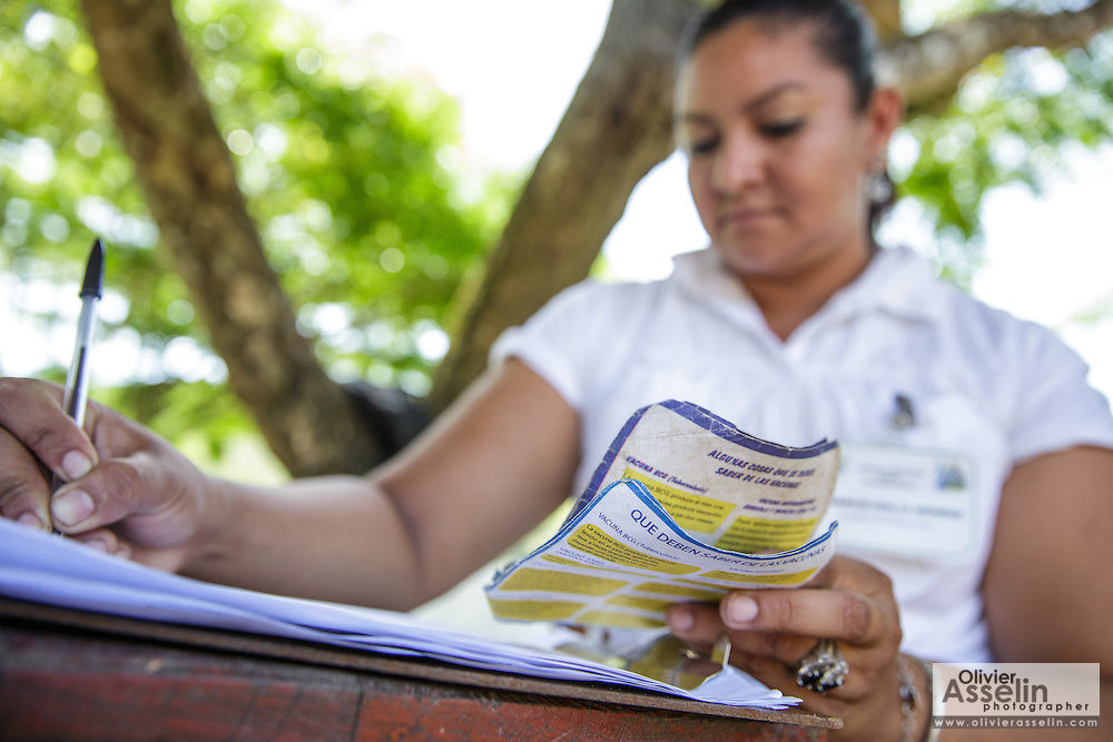 A health worker records children during a vaccination session at the primary school in the town of Coyolito, Honduras on Wednesday April 24, 2013.