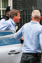 London, August 20th 2014. Prime Minister David Cameron arrives back at Downing Street after cutting short his holiday in Cornwall for urgent meetings with the Foreign Secretary and defence staff, in the wake of the execution by ISIL terrorists of Journalist James Foley by a man appearing to have a British accent.