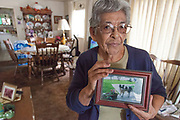 Vicki Yorba, 95, shows a photo of her front lawn in better times. Like many other residents of East Porterville, a small town at the eastern edge of the Central Valley, Vicki's well ran dry and now depends on bottled water being delivered by Donna Johnson who since last June has been distributing water to her neighbors in need. Tulare County, California, USA
