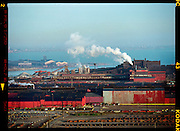 4_BOF.Indiana Harbor and Mittal Steel USA sit on the edge of Lake Michigan in East Chicago, Ind., The 2000 acre mill facility formally known as Inland Steel Company was established around 1901 and though a buyout in 2004 Mittal purchased the mill property for 17.8 billion.