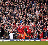 Photo. Glyn Thomas.<br /> Liverpool v Leeds Utd. Barclaycard Premiership.<br /> Anfield, Liverpool. 25/10/03.<br /> Liverpool fans celebrate as Michael Owen celebrates Liverpool's first goal of the day along with Steven Gerrard and John Arne Riise.