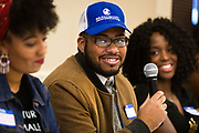 """Malik Anderson cracks a smile on the panel called """"Creating Impact and Staying Engaged While in College"""" during the Black Excellence Youth Conference at the Best Western Plus Inntowner on Monday, Jan. 15, 2018."""
