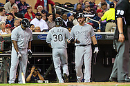 Alejandro De Aza #30 of the Chicago White Sox is congratulated by his teammates after scoring against the Minnesota Twins on May 13, 2013 at Target Field in Minneapolis, Minnesota.  The Twins defeated the White Sox 10 to 3.  Photo: Ben Krause