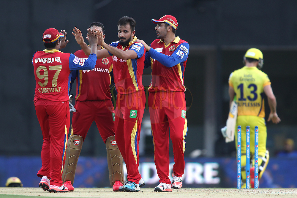 Sarfaraz Naushad Khan of the Royal Challengers Bangalore and Manvinder Bisla of the Royal Challengers Bangalore congratulate Harshal Patel of the Royal Challengers Bangalore for getting Faf Du Plessis of Chennai Super Kings wicket during match 37 of the Pepsi IPL 2015 (Indian Premier League) between The Chennai Superkings and The Royal Challengers Bangalore held at the M. A. Chidambaram Stadium, Chennai Stadium in Chennai, India on the 4th May April 2015.<br /> <br /> Photo by:  Shaun Roy / SPORTZPICS / IPL