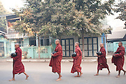Monks walking in procession for morning alms, Mandalay, Burma