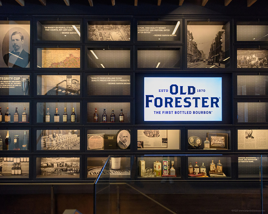 Founder George Garvin Brown's story is told in photos and memorabilia above a staircase as visitors tour the Old Forester Distilling Company on Whisky Row in Louisville, Ky. June 6, 2018