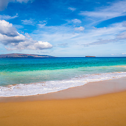 Big Beach Maui Hawaii photo with Molokini Crater and Kaho'olawe Island Reserve. Big Beach is in Wailea-Makena Hawaii and is one of Maui's most popular beaches. Copyright ⓒ 2019 Paul Velgos with All Rights Reserved.