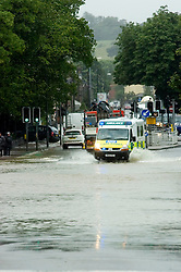 Torrential rain causes flooding and traffic chaos as an ambulance tries to make thier way through floodwater on The Common Ecclesfield Sheffield South Yorkshire.25 June 2007.Image COPYRIGHT Paul David Drabble.