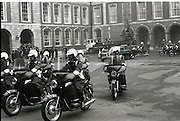 President Patrick Hillery Inauguration at Dublin Castle .03/12/1976.12/03/1976.3rd December 1976.Picture of army motorcycle outriders escorting the Presidents motorcade as it leaves Dublin Castle. President Hillery was Ireland's sixth President, he served two terms from 1976 to 1990.