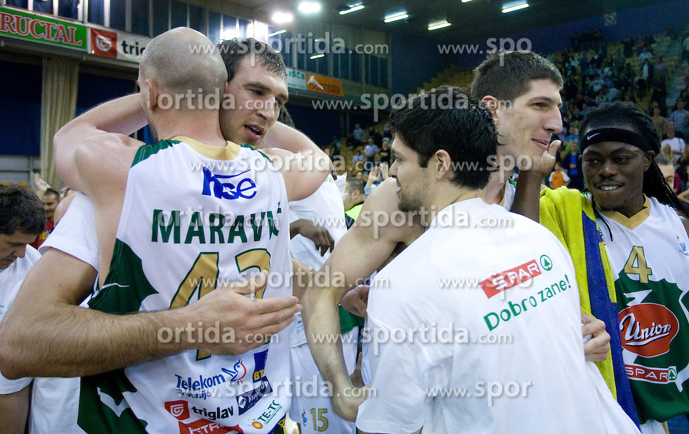 Marko Maravic, Vladimir Golubovic, Saso Ozbolt and Damjan Rudez celebrate at third finals basketball match of Slovenian Men UPC League between KK Union Olimpija and KK Helios Domzale, on June 2, 2009, in Arena Tivoli, Ljubljana, Slovenia. Union Olimpija won 69:58 and became Slovenian National Champion for the season 2008/2009. (Photo by Vid Ponikvar / Sportida)