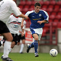 Clyde v St Johnstone...02.10.04<br />St Johnstone trialist Bobby Linn tries to break through the Clyde defence.<br />Picture by Graeme Hart.<br />Copyright Perthshire Picture Agency<br />Tel: 01738 623350  Mobile: 07990 594431