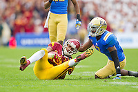 17 October 2012: Wide receiver (2) Robert Woods of the USC Trojans catches a pass and is tackled by (7) Tevin McDonald of the UCLA Bruins during the second half of UCLA's 38-28 victory over USC at the Rose Bowl in Pasadena, CA.