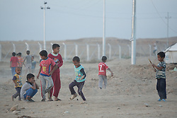 Licensed to London News Pictures. 22/10/2016. Iraqi refugee children play in the dust at the Dibaga refugee camp near Makhmur, Iraq.<br />