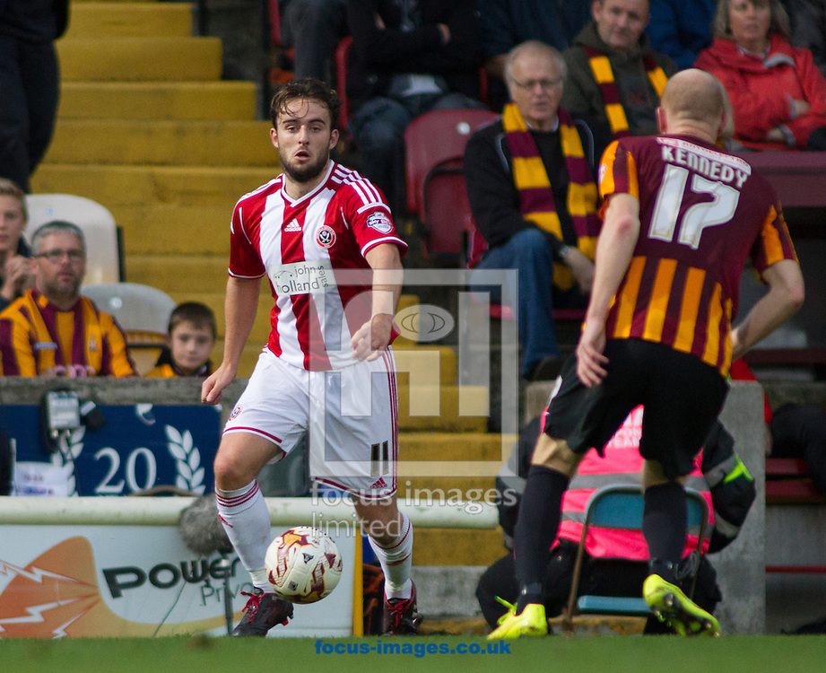 Jason Kennedy (R) of Bradford City tackles Jose Baxter (L) of Sheffield United during the Sky Bet League 1 match at the Coral Windows Stadium, Bradford<br /> Picture by Stephen Gaunt/Focus Images Ltd +447904 833202<br /> 18/10/2014
