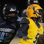 Cape Fear's Antonio Burden rushes against Hoggard's Yeremiya Andrews Friday November 21, 2014 at Hoggard High School in Wilmington, N.C. (Jason A. Frizzelle)