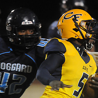 Cape Fear's Antonio Burden rushes against Hoggard's Yeremiya Andrews Friday November 21, 2014 at Hoggard High School in Wilmington, N.C. (Jason A. Frizzelle)