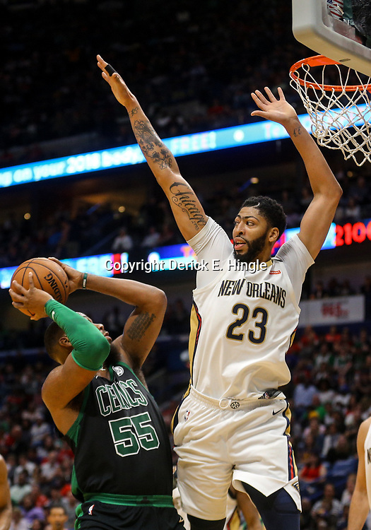 Mar 18, 2018; New Orleans, LA, USA; Boston Celtics center Greg Monroe (55) is defended by New Orleans Pelicans forward Anthony Davis (23) during the second half at the Smoothie King Center. Mandatory Credit: Derick E. Hingle-USA TODAY Sports