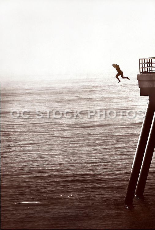 A Man Jumping Off The Huntington Beach Pier