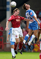 Photo: Daniel Hambury.<br />Walsall v Swindon. Coca Cola League 1.<br />03/09/2005.<br />Swindon's Michael Pook and Walsall's Craig Pead compete for the ball.