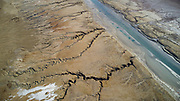 Aerial Photography with a drone. Elevated view of the canal leading water from the northern part to the Dead Sea Works, in the southern part on the shore of the Dead Sea, Israel.