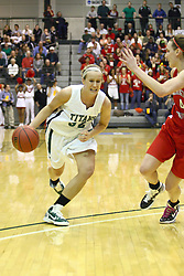 18 March 2011: Hope Schulte charges past the 3 point line being protected by Kathryn Berger during an NCAA Womens basketball game between the Washington University Bears and the Illinois Wesleyan Titans at Shirk Center in Bloomington Illinois.