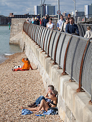 © Licensed to London News Pictures. 02/10/2016. Southsea, Hampshire, UK. People sunbathing on the beach and enjoying the warm, sunny weather on another stunning autumn day. Photo credit: Rob Arnold/LNP