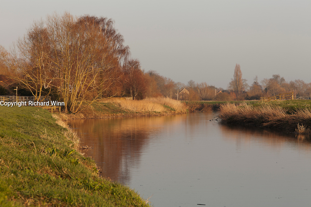 View of the River Parrett, from parkland on the edge of the Somerset town of Langport, looking east in the evening.