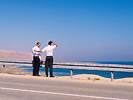 Tourists stand on the shoulder of Highway 90 overlooking the Dead Sea. WATERMARKS WILL NOT APPEAR ON PRINTS OR LICENSED IMAGES.