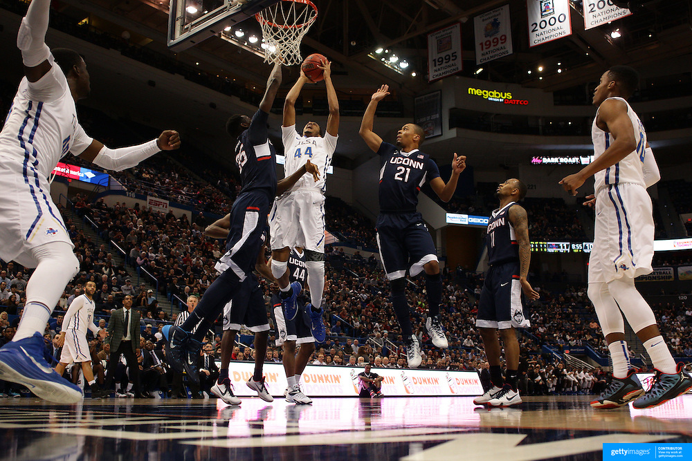 Brandon Swannegan, Tulsa, rebounds while challenged by Amida Brimah and Omar Calhoun, (right), UConn, during the UConn Huskies Vs Tulsa Semi Final game at the American Athletic Conference Men's College Basketball Championships 2015 at the XL Center, Hartford, Connecticut, USA. 14th March 2015. Photo Tim Clayton