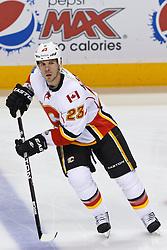Jan 17, 2012; San Jose, CA, USA; Calgary Flames defenseman Scott Hannan (23) warms up before the game against the San Jose Sharks at HP Pavilion. San Jose defeated Calgary 2-1 in shootouts. Mandatory Credit: Jason O. Watson-US PRESSWIRE