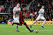 Callum Wilson (13) of AFC Bournemouth is chased by Phil Jones (4) of Manchester United during the Premier League match between Bournemouth and Manchester United at the Vitality Stadium, Bournemouth, England on 18 April 2018. Picture by Graham Hunt.