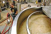 Matt Obrecht listens to instructions at O'Fallon Brewery.