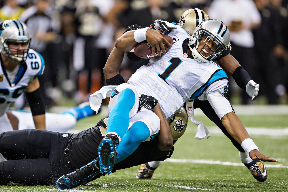 NEW ORLEANS, LA - DECEMBER 8:  Cam Newton #1 of the Carolina Panthers is sacked during a game against the New Orleans Saints at Mercedes-Benz Superdome on December 8, 2013 in New Orleans, Louisiana.  The Saints defeated the Panthers 31-13.  (Photo by Wesley Hitt/Getty Images) *** Local Caption *** Cam Newton