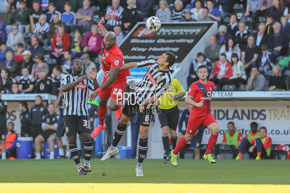 York City forward Emile Sinclair and Notts County defender Haydn Hollis in another battle  during the Sky Bet League 2 match between Notts County and York City at Meadow Lane, Nottingham, England on 26 September 2015. Photo by Simon Davies.
