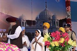 November 22, 2018 - Kolkata, West Bengal, India - West Bengal Chief Minister Mamata Banerjee (in middle) takes part in Guru Nanak Dev Ji birth anniversary celebration at Kolkata Maidan. (Credit Image: © Saikat Paul/Pacific Press via ZUMA Wire)