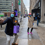 A couple practices social distancing on the sidewalk as Manhattan remains virtually empty with closed businesses and limited traffic due to the Coronavirus (Covid-19) outbreak in New York City on Monday, May 11, 2020.  Nonessential businesses have been closed and large gatherings have been banned across the state since March 22 under an emergency order issued by Governor Cuomo that is set to expire on Friday. (Alex Menendez via AP)