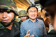 27 MAY 2014 - BANGKOK, THAILAND: Thai soldiers lead CHATURON CHAISANG out of the Foreign Correspondents' Club of Thailand after arresting him during a press conference. Chaturon, a former Deputy Prime Minister and Education Minister and a senior member of the Pheu Thai Party (the party of the elected civilian government) was arrested by military authorities in Bangkok while he was talking to reporters at the Foreign Correspondents' Club of Thailand. A squad of soldiers came into the packed FCCT dining room, confronted Chaturon and led him to a waiting van.     PHOTO BY JACK KURTZ