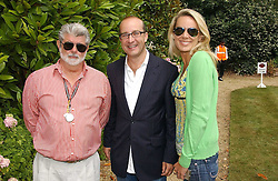 "Left to right, GEORGE LUCAS, PAUL MCKENNA and CLARE STAPLES at the Goodwood Festival of Speed on 9th July 2006.  Cartier sponsored the ""Style Et Luxe' for vintage cars on the final day of this annual event at Goodwood House, West Sussex and hosted a lunch.<br />