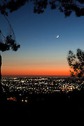 Twilight at Sunset.  Looking west toward the lights of La Mesa, the coast, the Sea World tower, and of course a new moon.