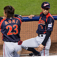 23 March 2009: #23 Norichika Nakajima of Japan and #51 Ichiro Suzuki are seen in the dugout during the 2009 World Baseball Classic final game at Dodger Stadium in Los Angeles, California, USA. Japan defeated Korea 5-3