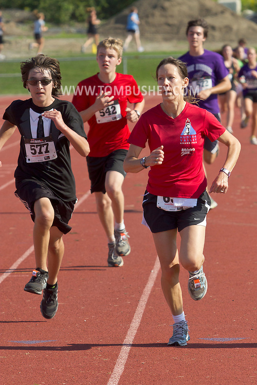 Central Valley, New York - Runners finish the Woodbury Country Ramble race on Aug. 26, 2012.