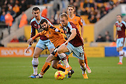Burnley midfielder Scott Arfield on the ball watched by Wolverhampton Wanderers midfielder Jack Price during the Sky Bet Championship match between Wolverhampton Wanderers and Burnley at Molineux, Wolverhampton, England on 7 November 2015. Photo by Alan Franklin.