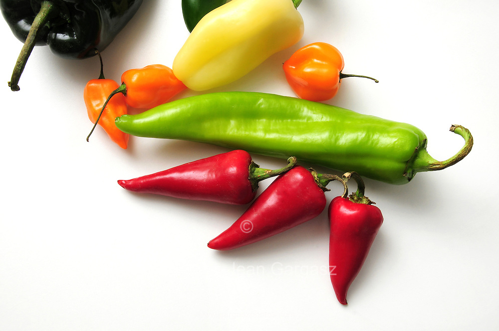 Chili peppers--Poblano Chili (big, dark green): Jalapeno (dark, slim green): Anaheim (long, light green); Red Fresno (red); Habanero (orange); Yellow Hots (light yellow)