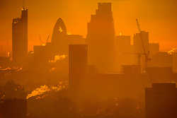 © Licensed to London News Pictures. 29/12/2016. London, UK. Sunrise over the city of London including The Gherkin building,  as seen from Parliament Hill on Hampstead Heath, Hampstead, North London on another cold winter morning. Most of the UK has woken to freezing temperatures. Photo credit: Ben Cawthra/LNP