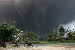 AUGUST 02, 2017 - Karo, Indonesia - A motorcyclist on the road while volcanic  ash spews from mount Sinabung as seen from Beganding Village at Karo, North Sumatra, Indonesia. Mount Sinabung is one of the most active volcanos in Indonesia. (Credit Image: © Yt Haryono/Xinhua via ZUMA Wire)