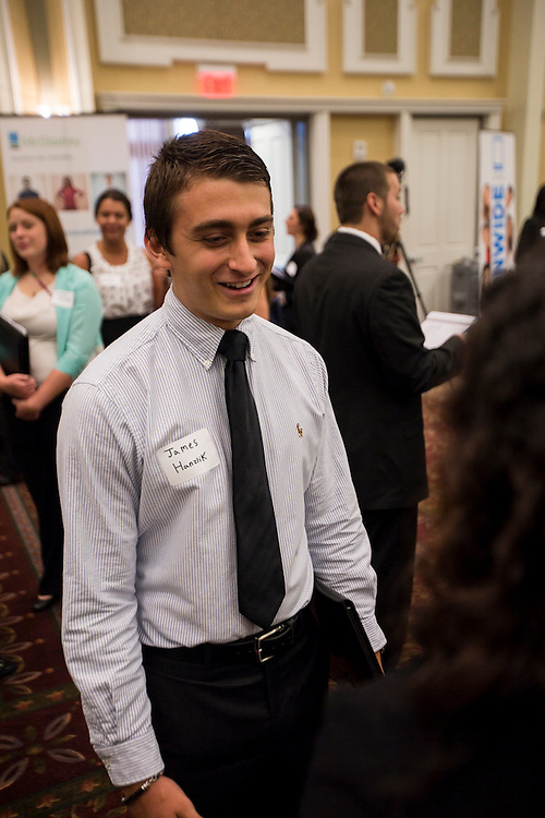"James Hanzlik chats with a representative at Thursday's ""Meet the Accountants"" event. Photo by Katelyn Vancouver"