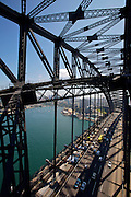 "Sydney Harbour Bridge, affectionately dubbed the ""coat hanger"", was completed in 1932. It is open to visitors by joining the famous ""BridgeClimb"" since 1998. Here shown is ""The Discovery Climb"" ascending and descending along the lower arches of the bridge, while also providing a view from the top in the middle."
